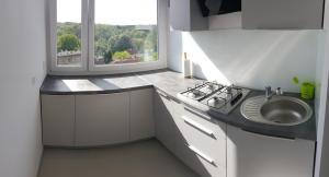 Küche/Küchenzeile in der Unterkunft Apartament Arkońska