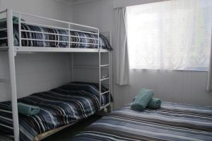 A bed or beds in a room at sonnblick lodge