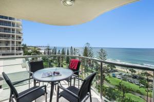 A balcony or terrace at Malibu Apartments