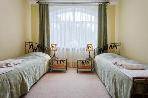 A bed or beds in a room at Villa Maria