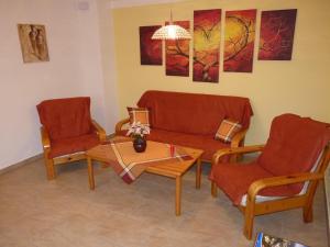 Ein Sitzbereich in der Unterkunft Ferienwohnung Hutterer