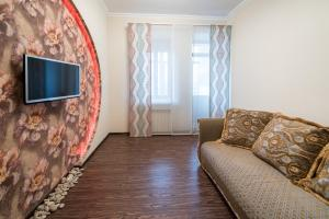 A television and/or entertainment center at Family Apartments on Galaktionova