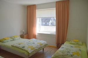 Voodi või voodid majutusasutuse Saare Automatic Hostel toas