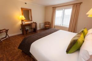 Cama o camas de una habitación en Lakutaia Lodge