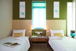 Ein Bett oder Betten in einem Zimmer der Unterkunft Uncle Loy's Boutique House