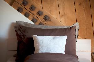 Ein Bett oder Betten in einem Zimmer der Unterkunft La Commanderie