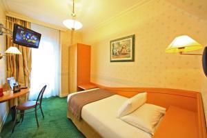 Un ou plusieurs lits dans un hébergement de l'établissement Best Western Beauséjour