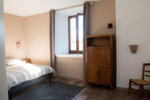 Кровать или кровати в номере La vallée de Gaïa