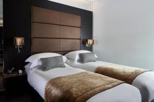 A bed or beds in a room at The Westbridge Hotel