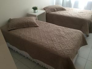 Cama ou camas em um quarto em Residencial Colibri