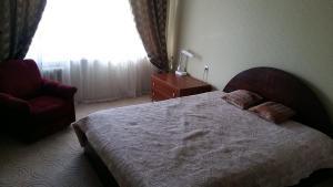 Кровать или кровати в номере Apartment on Sadovaya 5