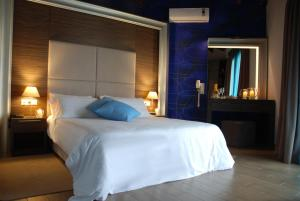 A bed or beds in a room at Imerti Resort Hotel