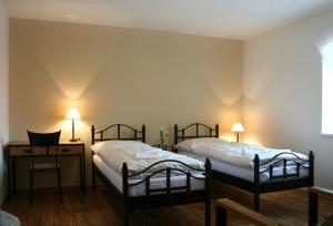 A bed or beds in a room at Hotel SRC Lihovar