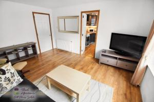 A television and/or entertainment center at Thistle Apartments - Marischal Square