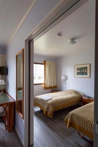 Vuode tai vuoteita majoituspaikassa Hotel Rinssi-Eversti