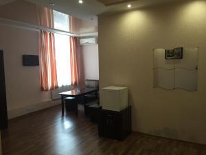 Телевизор и/или развлекательный центр в Отель «Двин»