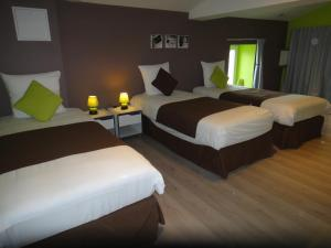 A bed or beds in a room at Le Domaine du Luth