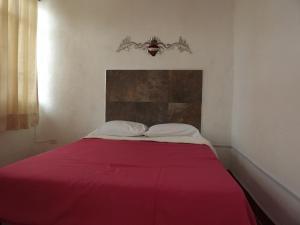 Cama o camas de una habitación en La Posada del Artesano