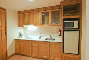 A kitchen or kitchenette at Harmoni Suites Hotel