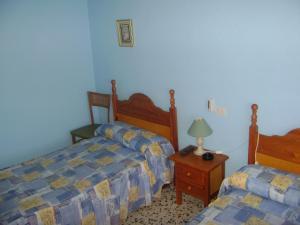 A bed or beds in a room at PENSIÓN EGEA 1