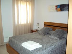 A bed or beds in a room at Casa do Mosteiro de Refoios do Lima