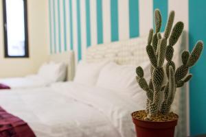 花蓮愛玩客民宿房間的床