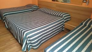 A bed or beds in a room at Hotel Urbis