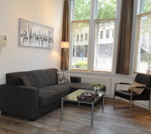 Coin salon dans l'établissement Appartement Leiden City Center