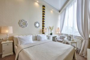 A bed or beds in a room at Grand Wellness Novahovo Hotel & Spa