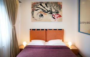 A bed or beds in a room at Casa Biota Boutique (Adult Only)