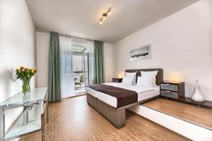 Een bed of bedden in een kamer bij Ostrovni 7 Apartments