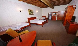 A bed or beds in a room at Mini Hotel Abraka