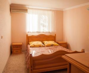 Кровать или кровати в номере Raiskiy Ugolok
