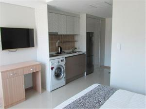 A kitchen or kitchenette at J Hotel