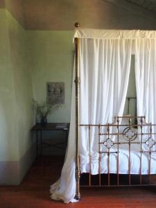 Uma cama ou camas num quarto em Convento Senhora da Vitória