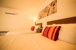 Кровать или кровати в номере Hotel Soleira