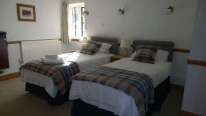 A bed or beds in a room at The Helyar Arms