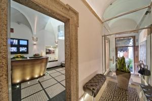 The lounge or bar area at Navona Palace Luxury Inn