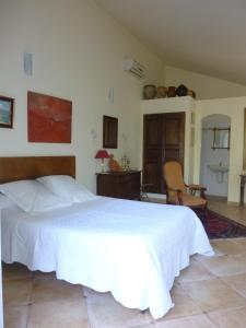 A bed or beds in a room at A camera di a vigna