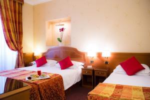 Cama o camas de una habitación en Hotel Amadeus