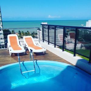 The swimming pool at or near Apartamento na Praia de João Pessoa