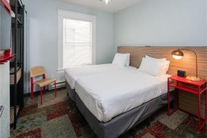 A bed or beds in a room at Minna Hotel