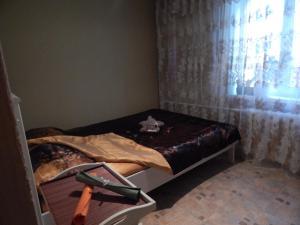 Кровать или кровати в номере Apartment Gagarina 32