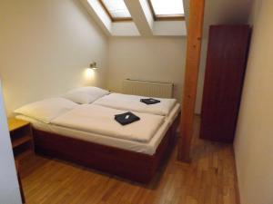 Кровать или кровати в номере Beta Pension