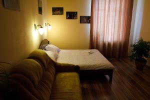 """A bed or beds in a room at Apartments """"The cultural capital"""""""