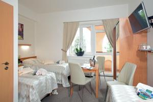 Ein Zimmer in der Unterkunft Wine Pension Prague