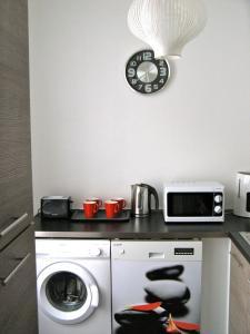 Cuisine ou kitchenette dans l'établissement Résidence Longchamp