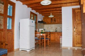 A kitchen or kitchenette at Athina Studios