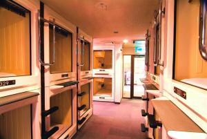 A bunk bed or bunk beds in a room at Capsule Hotel & Sauna Ikebukuro Plaza
