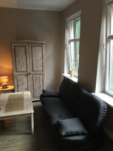 A seating area at Kawalerka Fredry 3/12